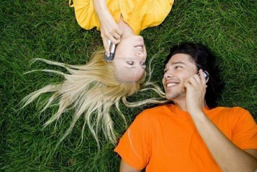 3389975-couple-talking-on-mobile-phones1.jpg